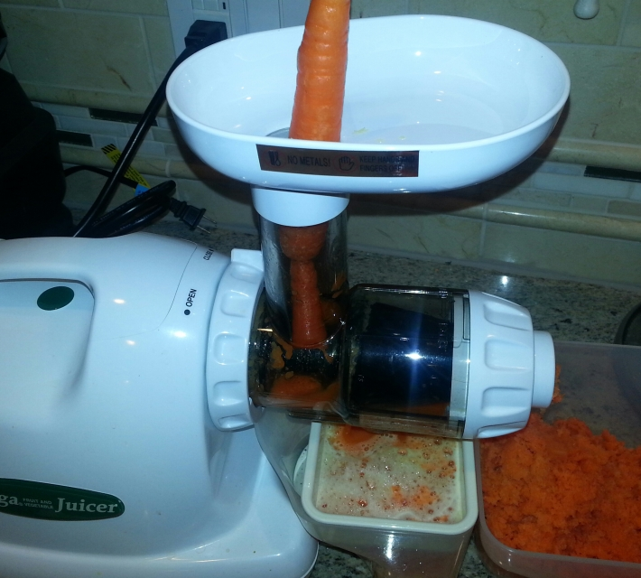 Juicing carrots in the Omega Juicer